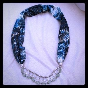 Scarf with attached necklace